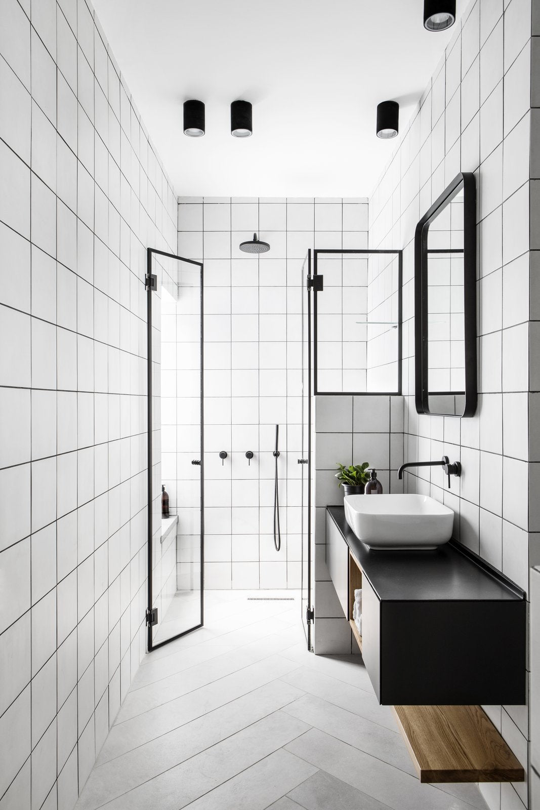 Modern black and white bathroom with floating sink unit