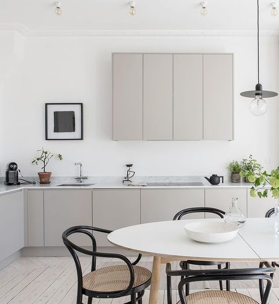 Taupe kitchen with black dining chairs