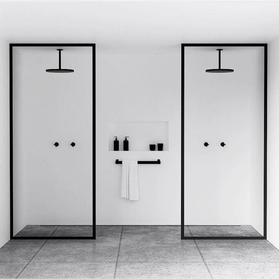 Monochrome bathroom with double shower and black features