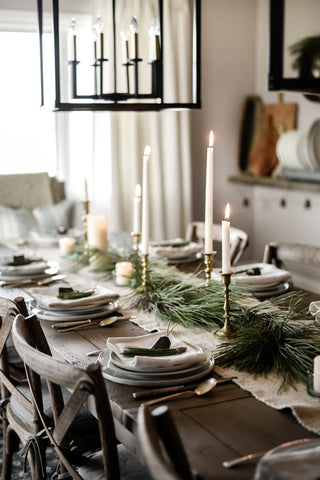 Christmas table with candles and foliage