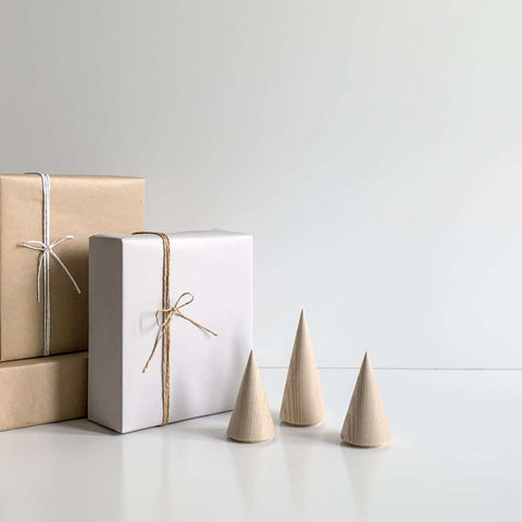 Wooden christmas trees and wrapped parcels