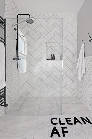 White bathroom with Herringbone tiles