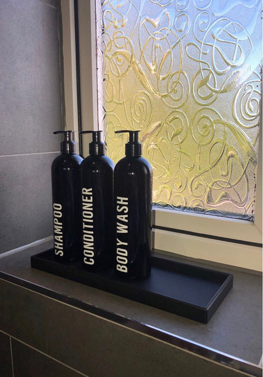 Bathroom window sill with tray and toiletries