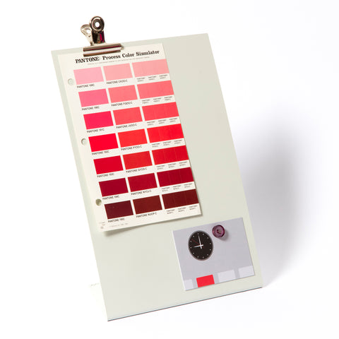 White clipboard with paint swatches