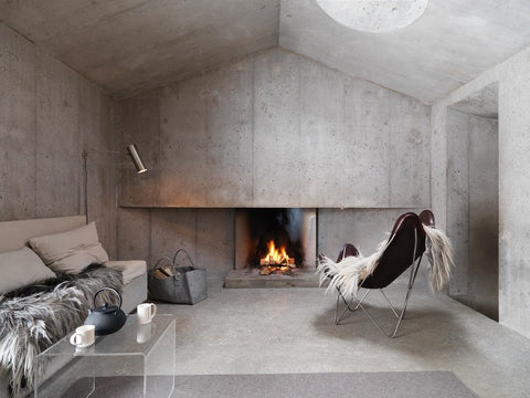 Entirely concrete living room with open fire