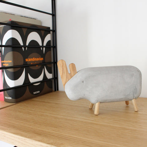 Concrete rhino ornament on shelf