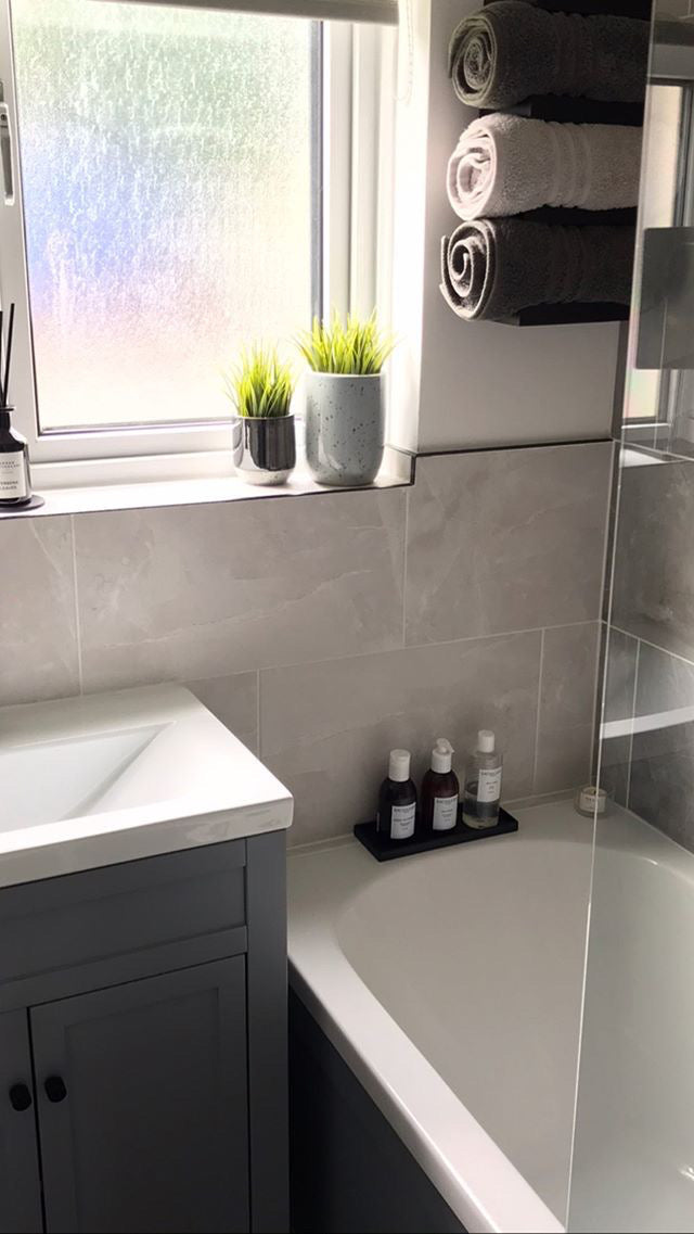 Modern bathroom with monochrome accessories and plants