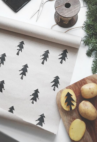 Potato printing wrapping paper with a Christmas tree design
