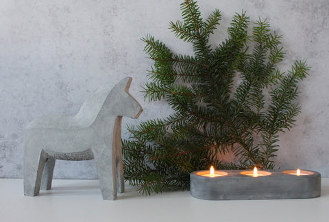 Concrete Dala Horse with concrete candle holder and fir