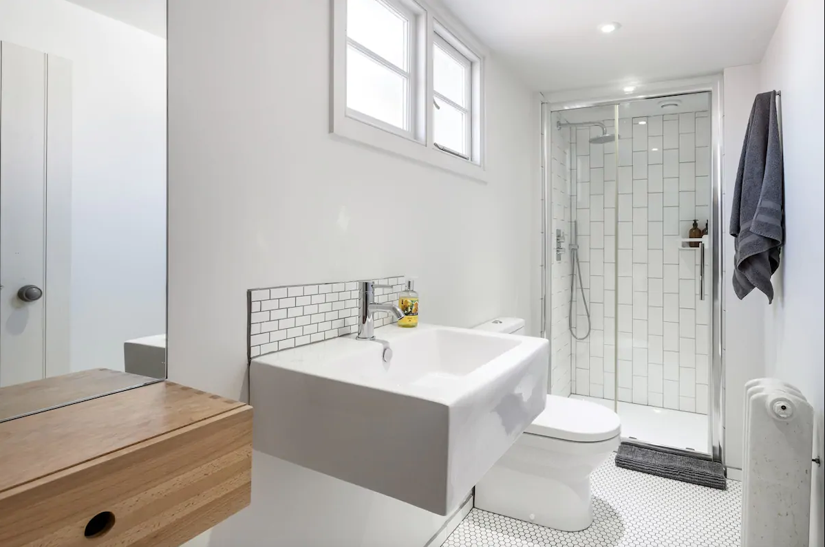 Modern monochrome bathroom with metro tiles and walk-in shower
