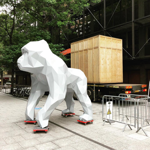 Giant geometric gorilla sculpture on wheels