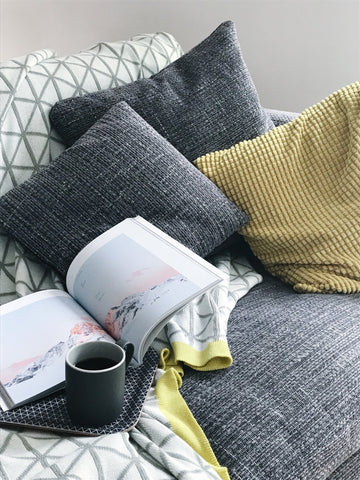 Sofa with cushions, magazine and tea tray