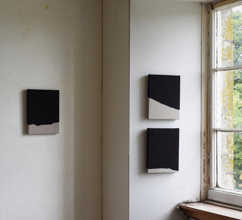 Triptych of linen artwork on a wall