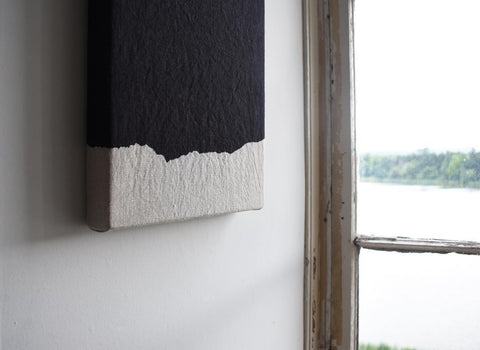 Linen artwork hanging on the wall