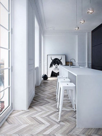 White kitchen with herringbone floor