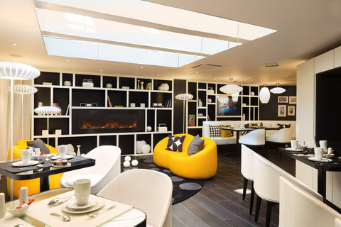 Hotel lobby, monochrome with yellow sofas