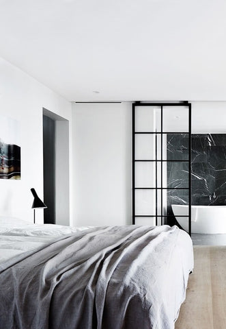 Light bedroom with internal glass doors