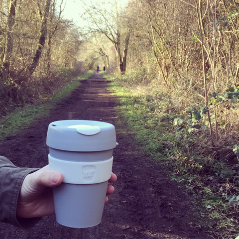 KeepCup on a wooded path