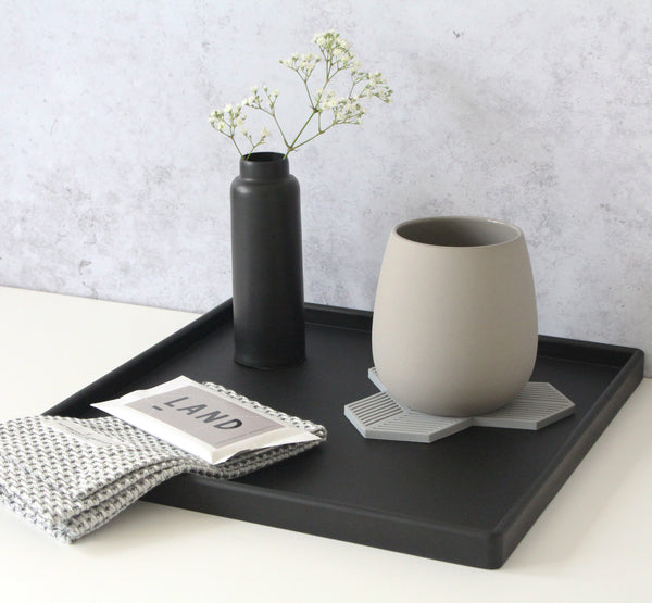 Large square rubber tray with flower vase, tea mug, mini chocolate bar and cloth