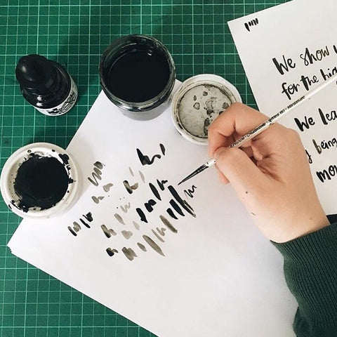 Hand brush lettering with black ink