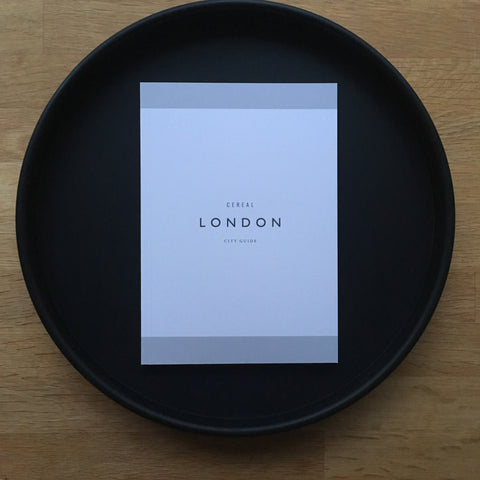London travel guide on tray