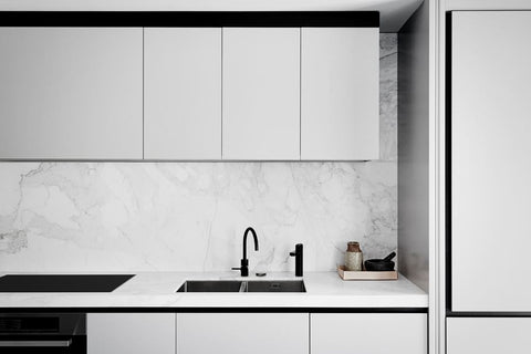 Grey kitchen with marble backsplash