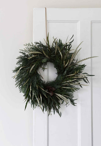 Grassy green wreath hanging on door