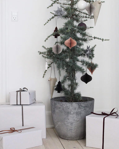 Potted Christmas tree with paper decorations