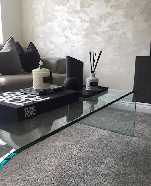 Coffee table with Tom Ford book, black tray with reed diffuser