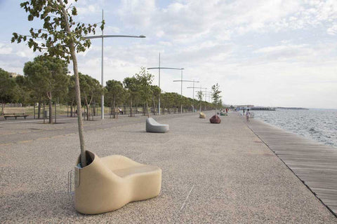 Street furniture with integral trees, by the sea