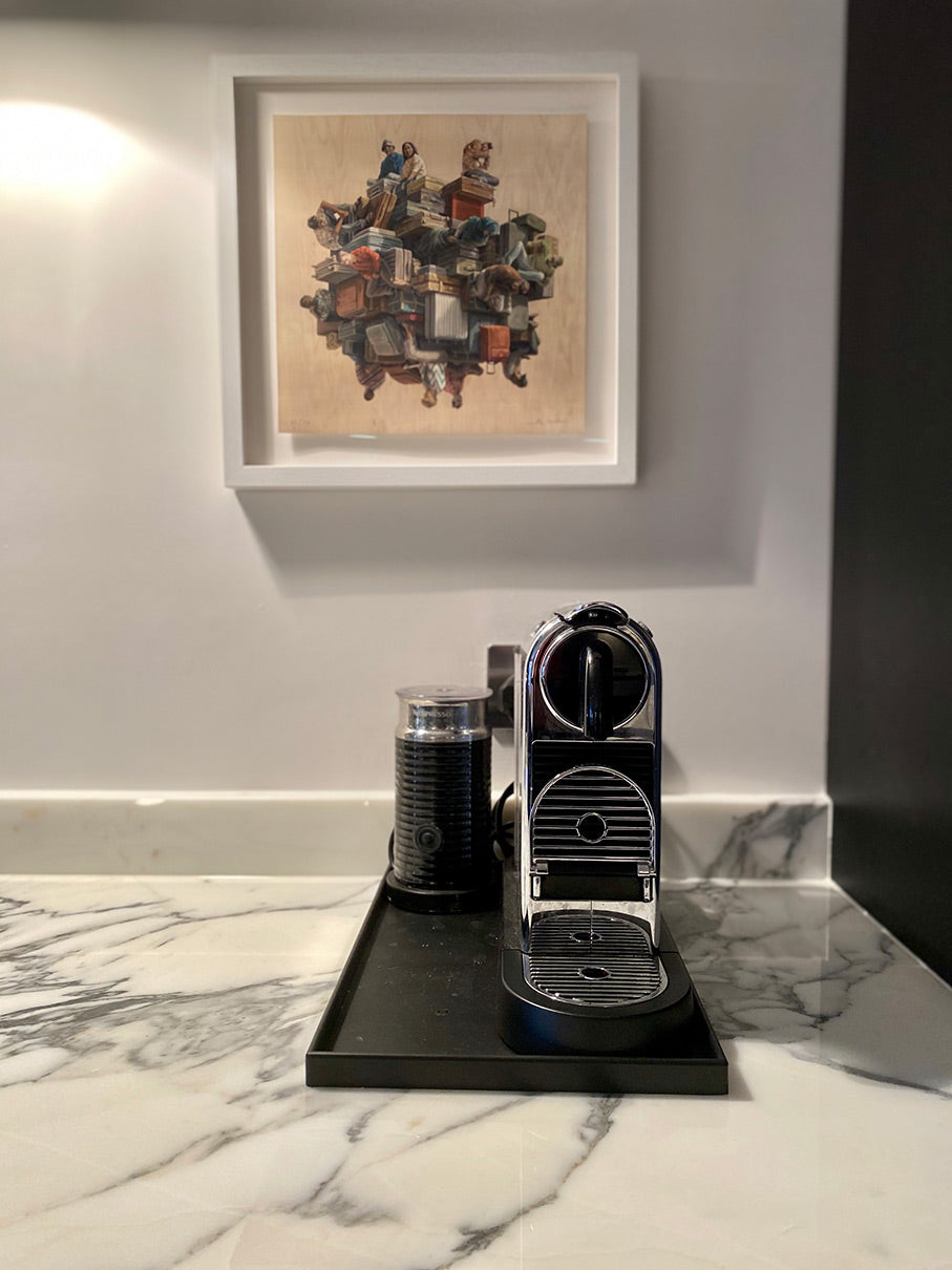 Marble countertop with coffee machine on black rubber tray