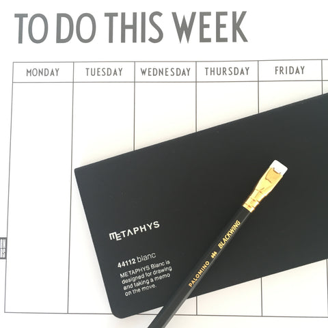 Planner, notebook and pencil