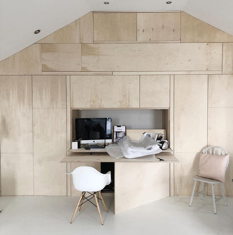 Plywood wall folding out to desk area