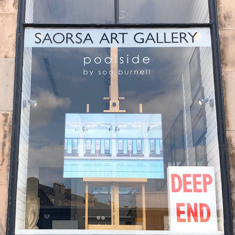 Gallery window with poolside images