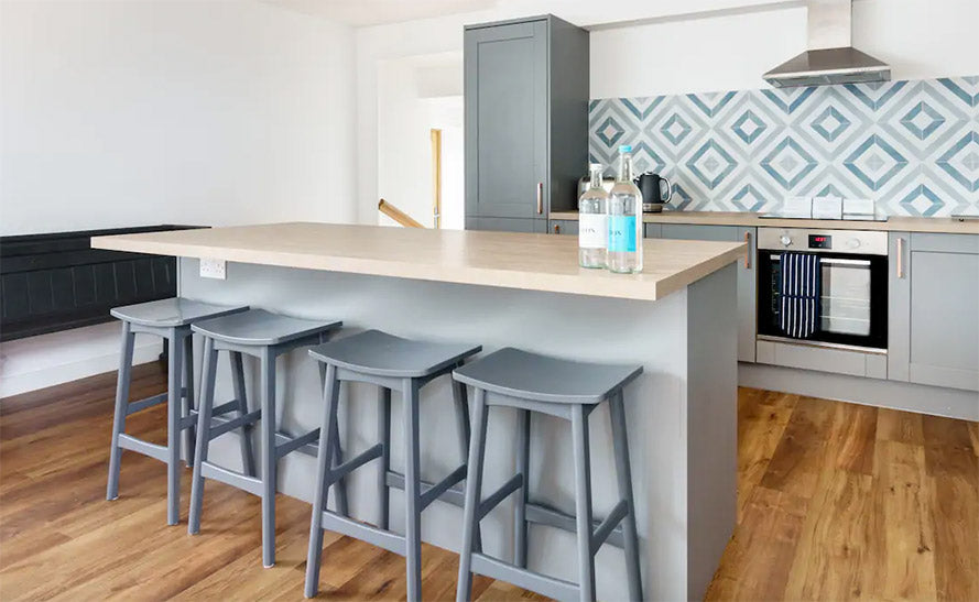 Modern kitchen with blue tiles and island
