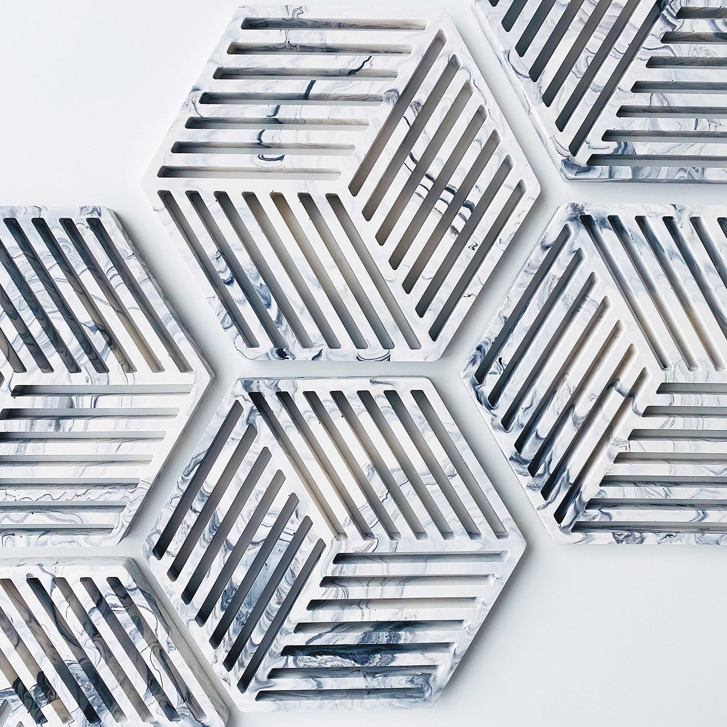 Collection of marbled grey hexagon trivets