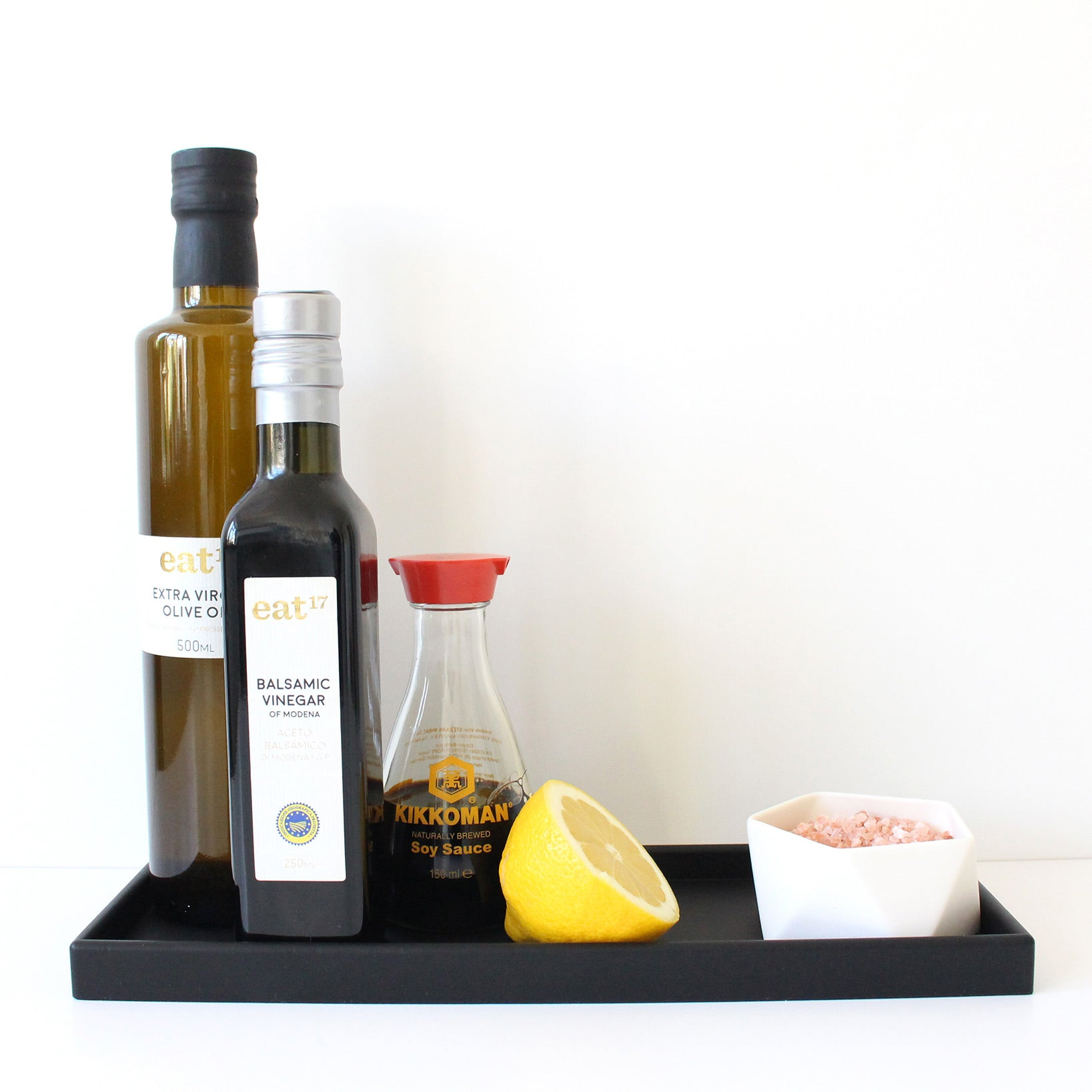 Black rubber kitchen tray with condiments