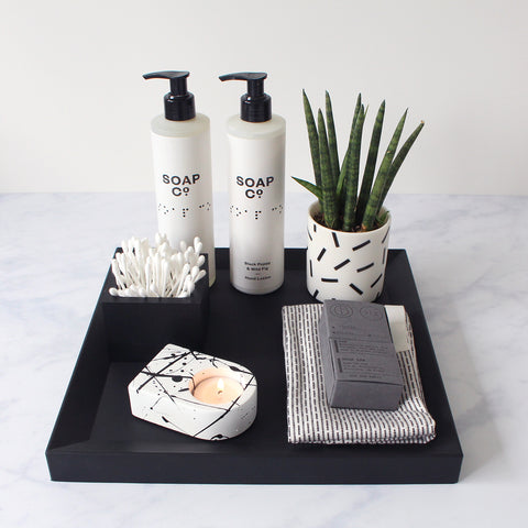 Bathroom tray with soap, plant, candle etc.