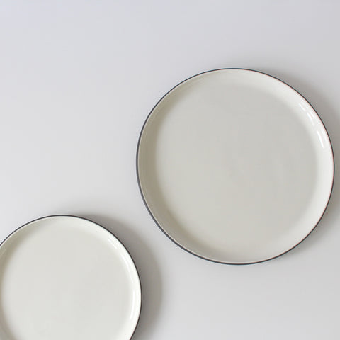 white and grey ceramic plates, from above