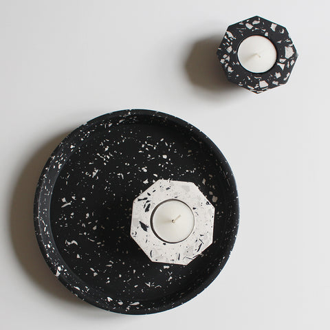 Monochrome terrazzo accessories - tealight holders on a round tray