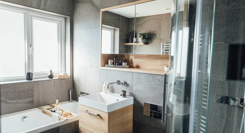 Modern bathroom, with grey walls and lots of wood