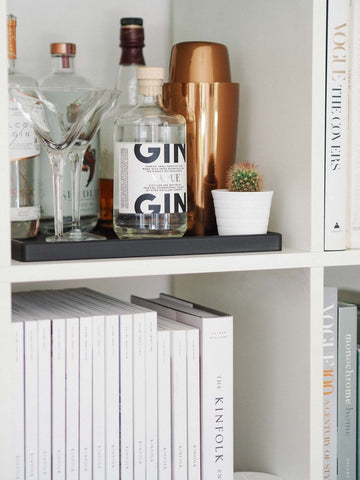 Bookcase bar with gin and accessories