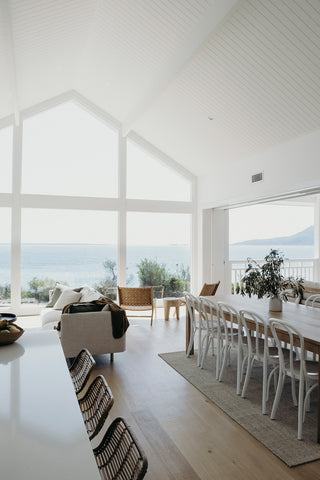 Double height dining space with sea view