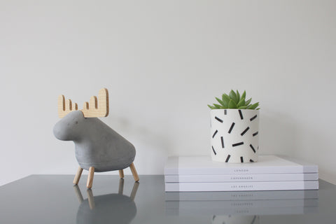 Small Speckle Pot by Jack Laverick together with Cereal Travel Guides and a Concrete Moose