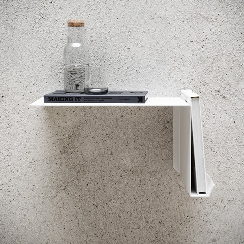 White metal bedside shelf with books and water bottle