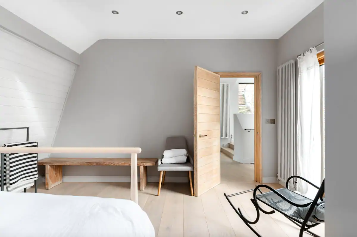 Modern bedroom in pale wood and grey