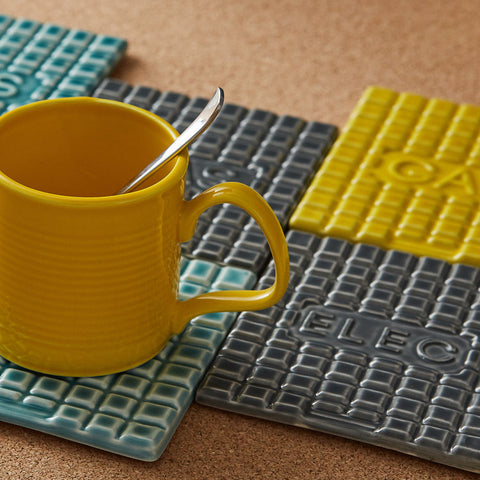 Ceramic coaster tiles with yellow mug