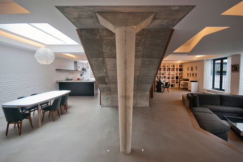 Open plan house interior with concrete pillar