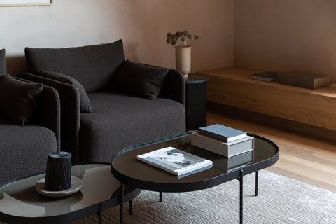 Modern grey armchairs and coffee tables