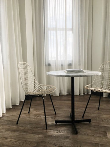 Little dining table with two white chairs
